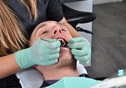 Man receiving dental care